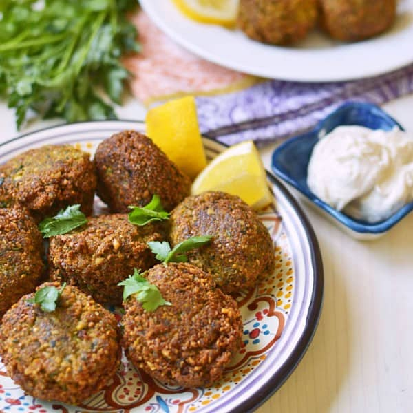 Learn how to make homemade Lebanese falafel recipe with dried chickpeas, loads of fresh herbs and warm spices. Serve with creamy tahini yogurt.