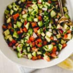 The perfect accompaniment to any Mediterranean dish, Israeli chopped salad is simple and fresh with tomatoes, cucumbers, fresh herbs and bright lemon.