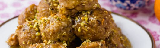 Baklava Bimuelos: Sephardic Passover Matzo Donuts Fried and Doused in a Thick Rose Water Syrup with Pistachios.