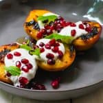 Simple summer dessert recipe, charred peaches with creamy and tangy labneh and topped with sweet honey and tart pomegranate seeds.