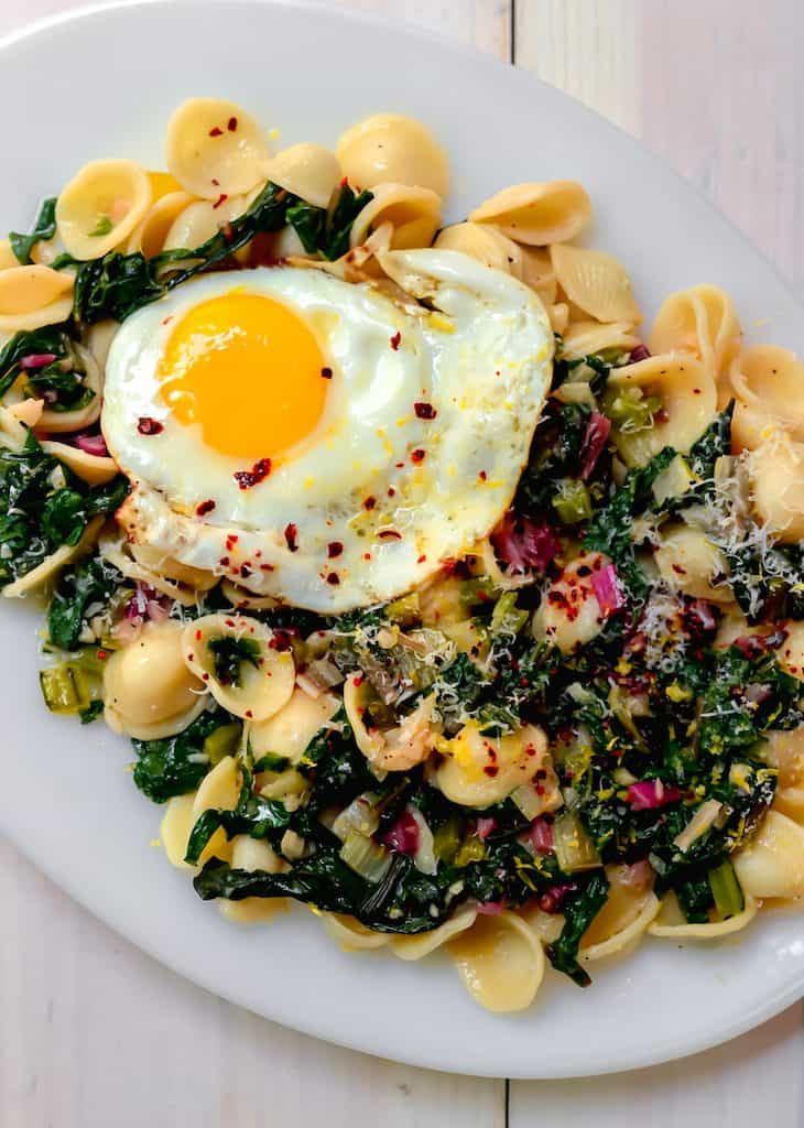 A simple chard pasta recipe, Orecchiette with Swiss Chard, Parmesan and fresh Lemon is light and quick to make for a weeknight dinner.