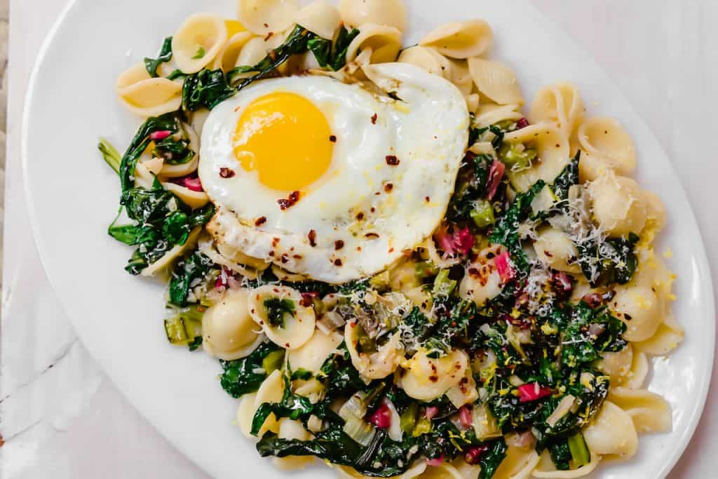 A simple chard pasta recipe, Orecchiette with Swiss Chard, Parmesan and fresh Lemon is light and quick to make for a weeknight dinner. #swisschard #pastarecipe