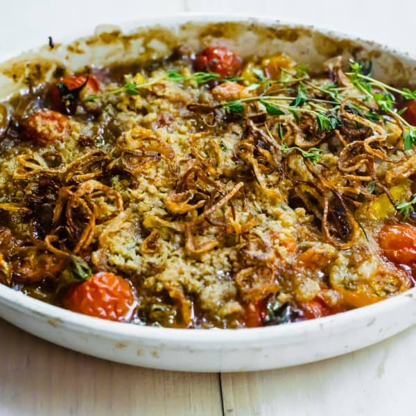 End of summers tomatoes is the perfect time to make a savory tomato crumble topped with crispy fried shallots and herb crumb topping.