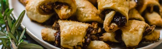 Rosemary and Fig Rugelach is a play on the traditional Jewish cookie, with sweet fig jam, caramelized walnuts and a touch of fresh rosemary for a sweet and slightly savory bite.