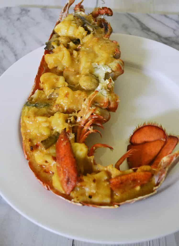 Learn to make Julia Child's Lobster Thermidor recipe. A creamy and decadent lobster dish with white wine, mushrooms and splash of cognac. #JuliaChild #LobsterThermidor