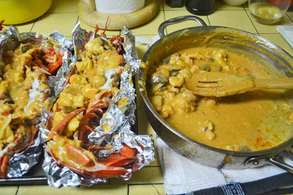 Scoop the lobster and the lobster thermidor sauce into the hollowed out lobster shells and place on a baking sheet before browning the top.
