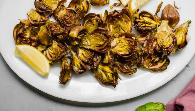 Roman style fried artichokes. Crispy baby fried artichokes fried in olive oil served with flakey salt and lemon juice. #FriedArtichokes #RomanFriedArtichokes
