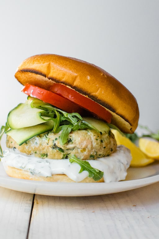 Mediterranean salmon burgers made with wild caught salmon with bright flavors salty preserved lemon, loads of fresh herbs and warm spices.