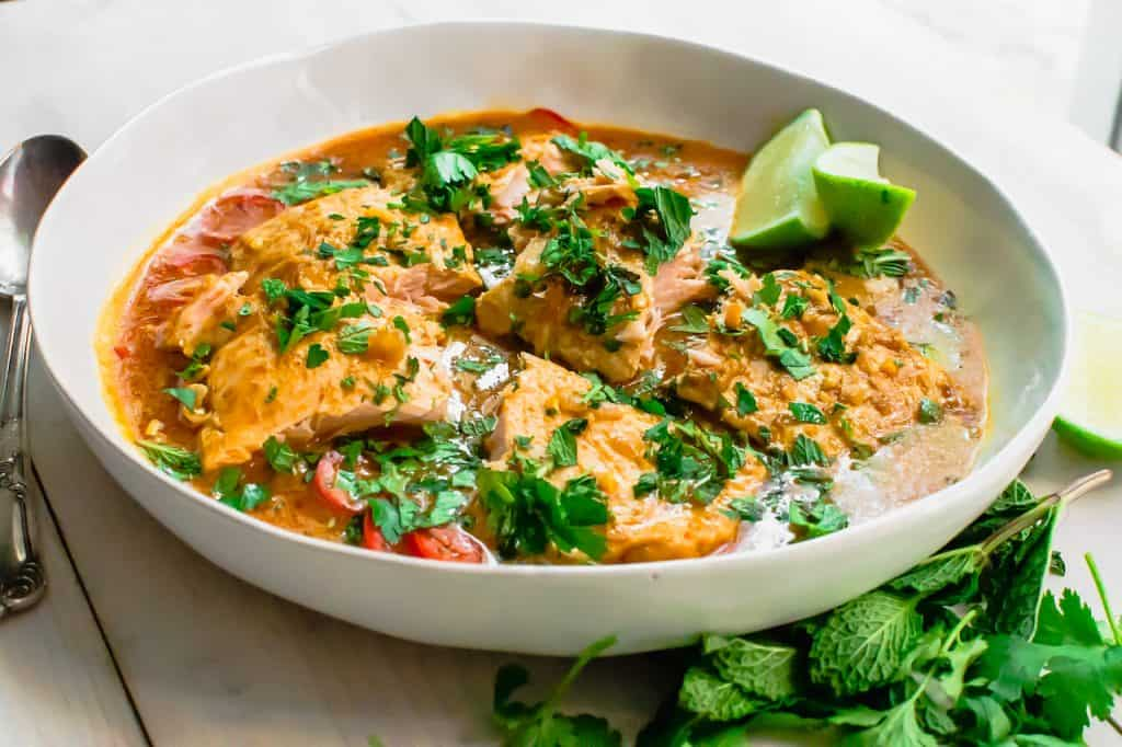 A simple salmon curry with with strong Thai flavors of ginger, galangal and lemongrass. Serve with basmati rice for a flavorful and quick weeknight dinner.