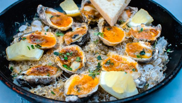 Inspired by a New Orleans favorite, these charbroiled oysters are cooked with paprika herb butter and topped with Parmesan cheese and lemon.