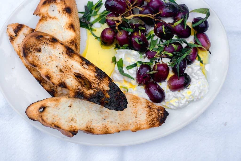 Sweet and smoky grilled grapes with burrata and tossed with fruity olive oil and elegant tarragon. Serve with crusty bread for an impressive and easy appetizer.
