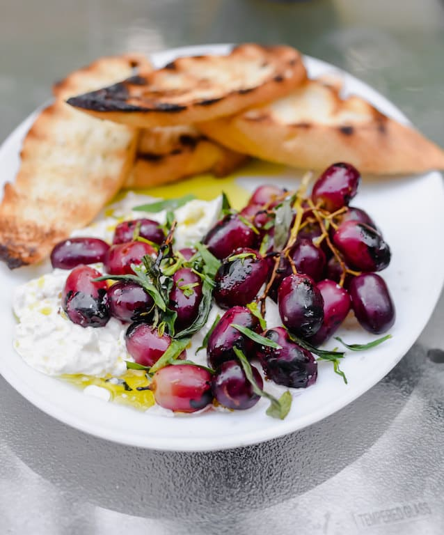 Sweet and smoky grilled grapes with buratta and tossed with fruity olive oil and elegant tarragon. Serve with crusty bread for an impressive and easy appetizer.