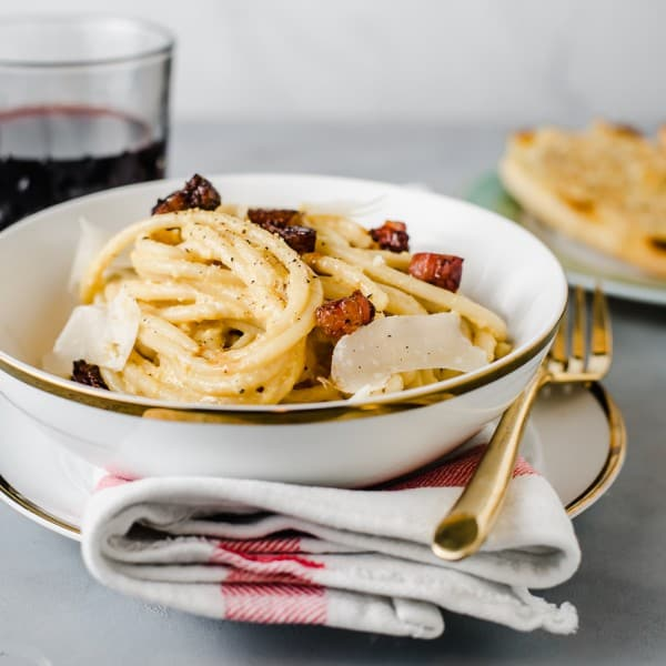 A classic Roman dish, bucatini carbonara with guanciale, whisked eggs and extra cheese.