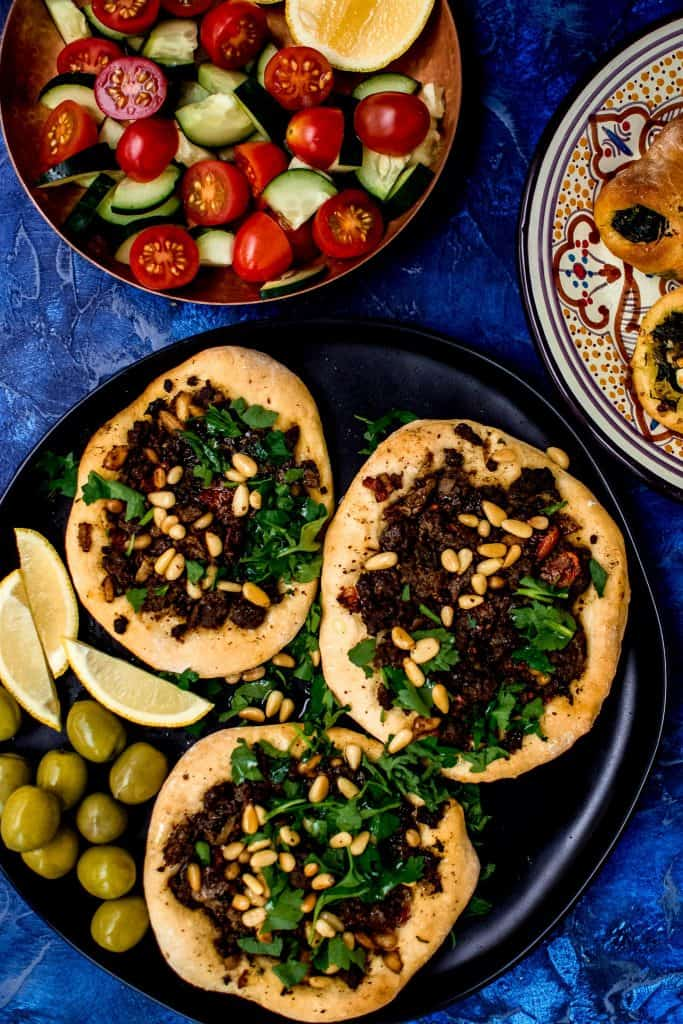 Inspired by the savory Lebanese Meat Pies called sfeeha, these open faced pies are topped with spiced lamb or beef and garnished with bright lemon and fresh herbs.