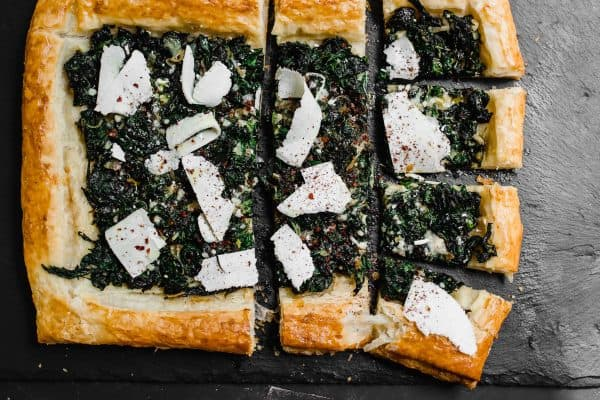 The perfect use for an abundance of garden greens. Sauteed Swiss chard is layered on top of butter puff pastry and finished with tangy sumac and strips of ricotta salata cheese.