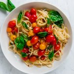 15 minute cherry tomato pasta is what summer dinners are made for! Sweet cherry tomatoes burst in olive oil and lots of garlic, creating the most delicious, slightly sweet and bright summery pasta.
