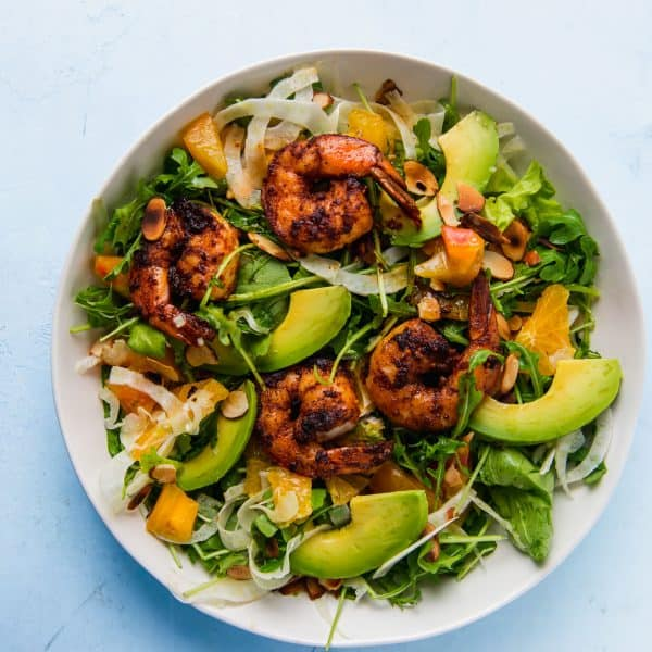 Grilled shrimp salad is fresh and hearty and full of spicy arugula, creamy avocado, thinly sliced fennel all dressed in a citrus vinaigrette.