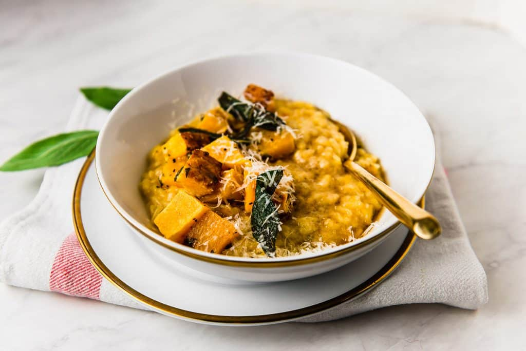 The epitome of fall comfort food, done in half the time as traditional risotto. Butternut squash risotto flavored with floral saffron and topped with brown butter, crispy sage and a good grating of Parmesan.