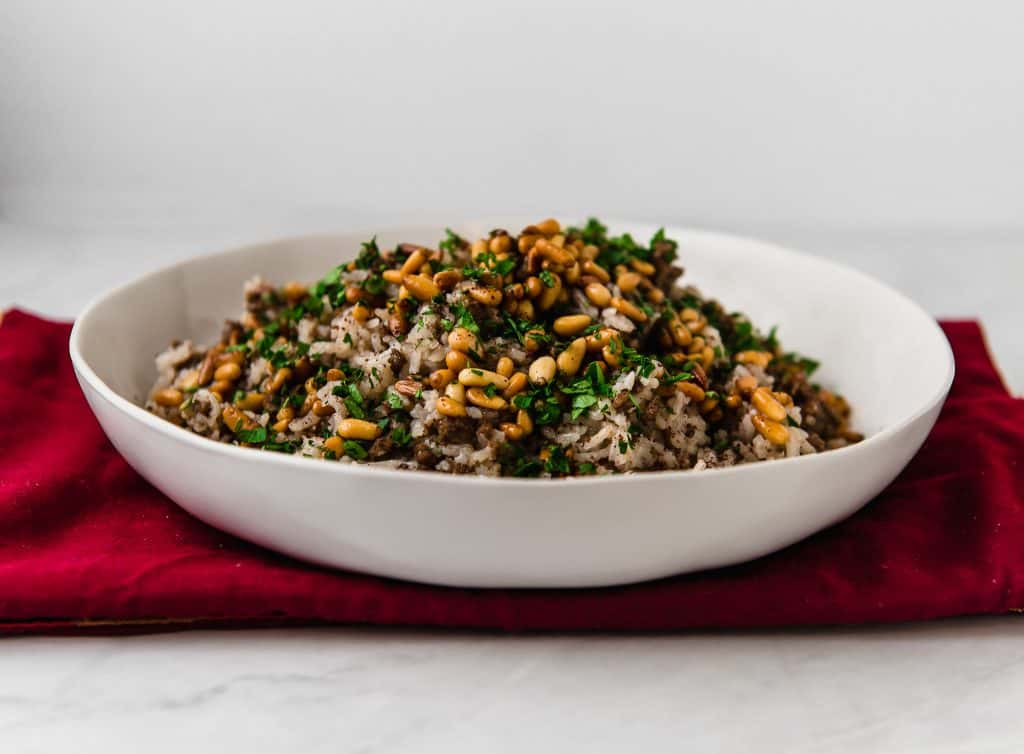 """A decadent and impressive spiced rice dish that literally translates to """"stuffing"""". Layered with warm spices of cinnamon and allspice, savory ground beef and toasted pine nuts."""