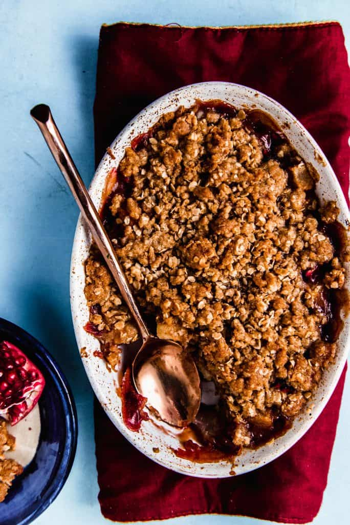 Pear and pomegranate crumble flavored with orange zest and vanilla paste is a simple and impressive weeknight dessert.