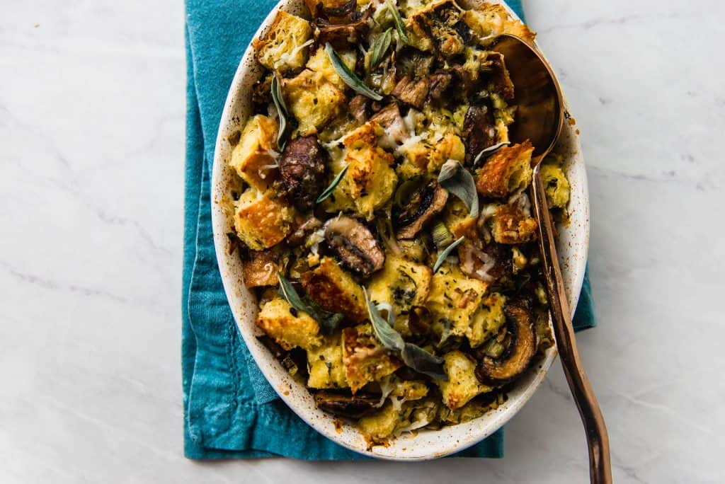 A modern spin on traditional stuffing, this savory bread pudding is filled with bold flavors of sauteed leeks, herb sauteed mushrooms and a good amount of nutty and savory Gruyere.