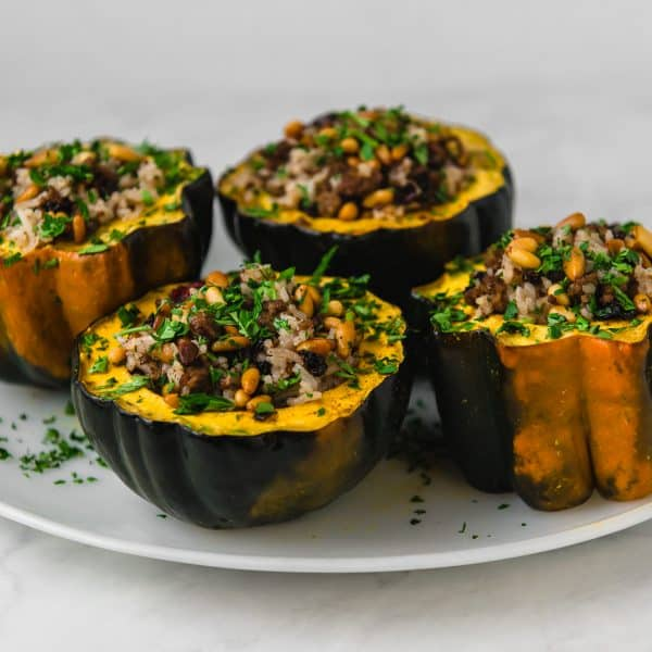 Acorn squash is stuffed with a Lebanese rice mixture called hashweh that is layered with warm spices of cinnamon, ground beef and tart cranberries.