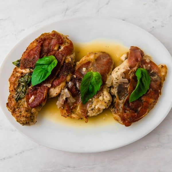 A twist on the popular Italian dish, this version of chicken saltimbocca has pounded chicken cutlets with aromatic herbes de Provence, smoky speck and fresh basil that is finished in a light white wine sauce.