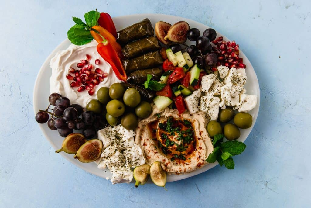 Learn to make a colorful and flavorful vegetarian mezze platter with all the Mediterranean favorites, including stuffed grape leaves, hummus and fresh fruit and vegetables.