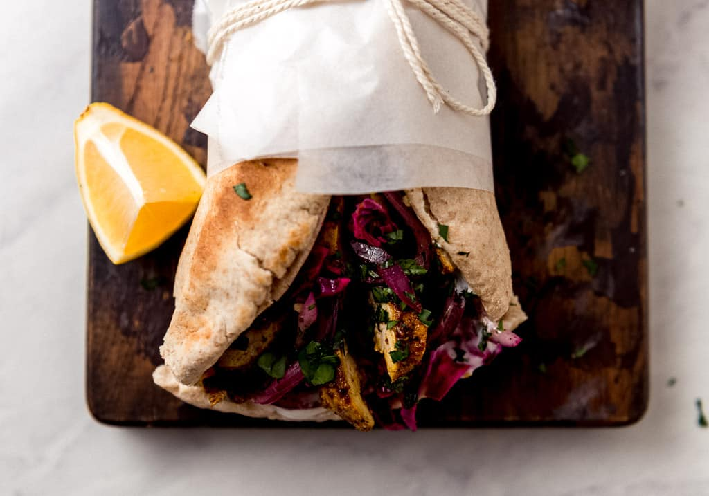 Chicken Shawarma Wrap with sumac onions and creamy tahini sauce.