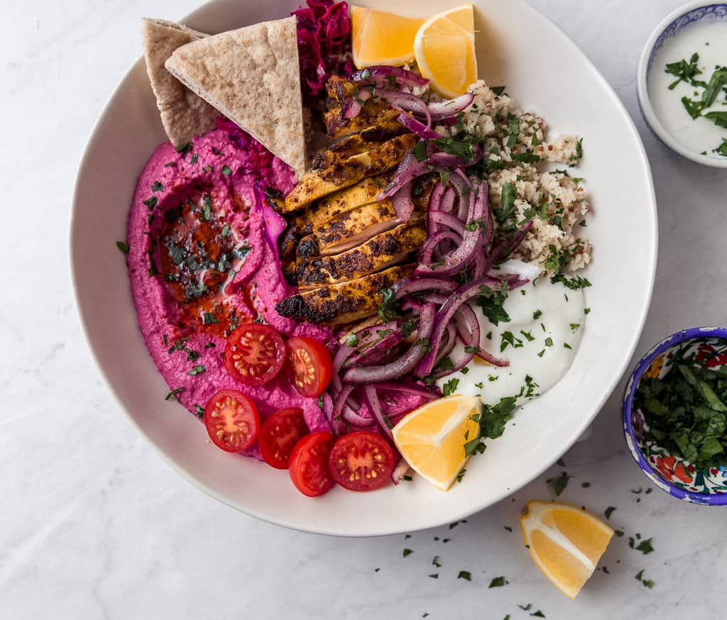Middle Eastern chicken shawarma recipe will be your favorite way to cook chicken. Serve chicken shawarma bowls with quinoa, hummus and creamy tahini.