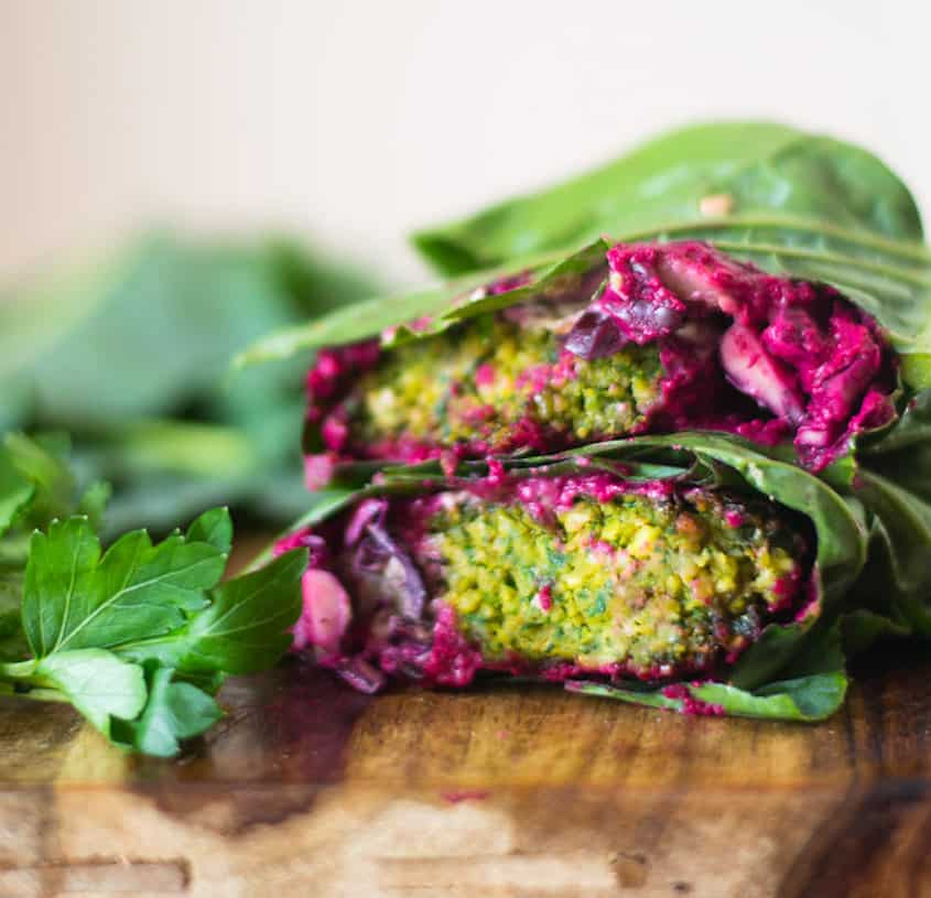 Falafel Collard Wrap with all the fillings including grilled eggplant, creamy tahini sauce, beet hummus and fresh cabbage!