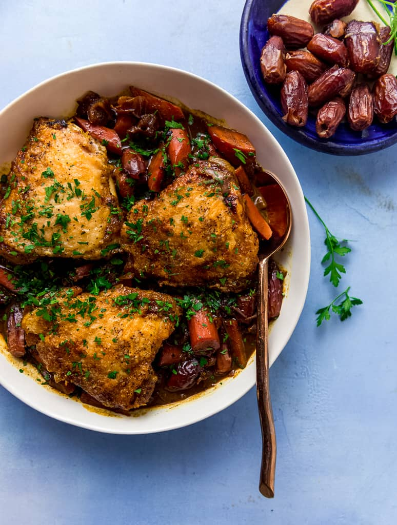 Braised chicken with dates, red wine and saffron is a gorgeous main course with layers of bold, slightly sweet and savory flavors.