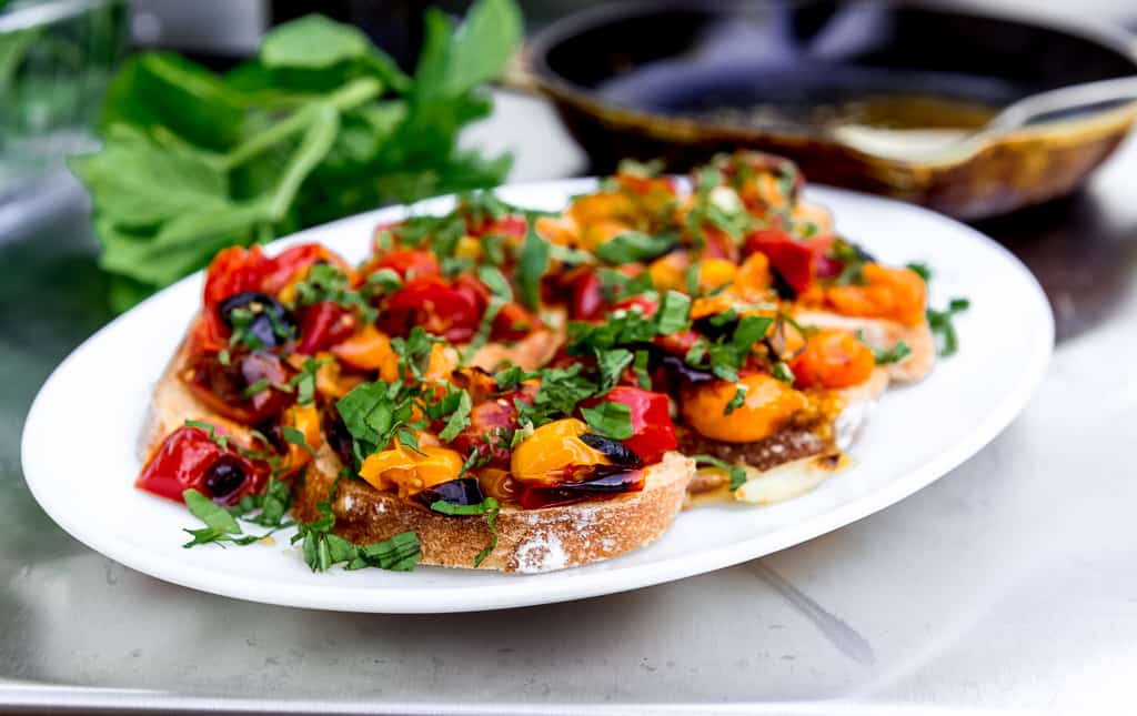 When tomatoes are at their peak, roasted tomato bruschetta is on the menu! Served over crostini, fresh basil and fruity olive oil.