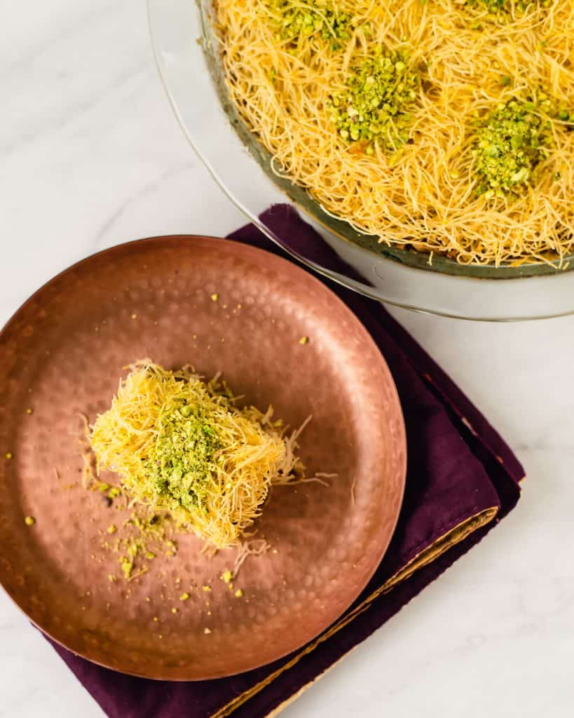 Kadaif AKA kadayif is a Middle Eastern dessert made of shredded phyllo, spiced pistachios and finished with orange blossom simple syrup.