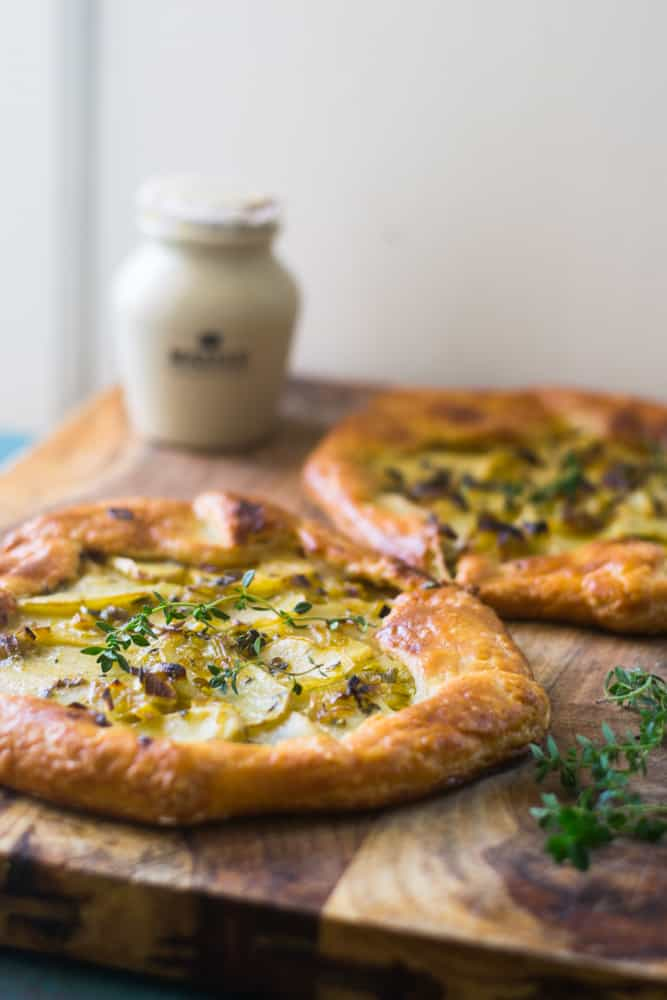 Potato leek tart is an impressive savory tart inspired from the famous potato leek soup, vichyssoise. The savory tart boasts big bold flavors and is layered with a Dijon bechamel, savory leeks and bright fresh thyme.